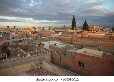 A panoramic view over the fortified ancient city of Marrakech, Morocco in the late afternoon sun.