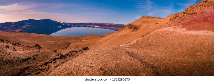 Panoramic view over Icelandic landscape of big volcanic caldera Askja, in the middle of volcanic desert in Highlands, with red, turquoise and orange volcano soil at sunset colors, Iceland