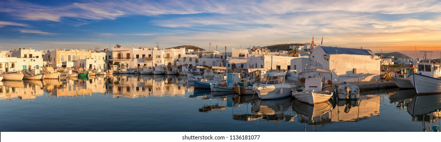 Panoramic view over the idyllic harbour of Naousa on the island of Paros during sunset time, Cyclades, Greece