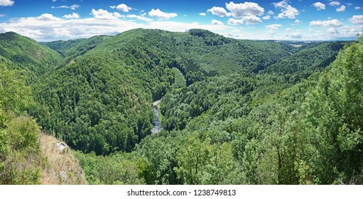 Panoramic view over Kamp river valley overgrown by natural primeval-like forest in Austria.