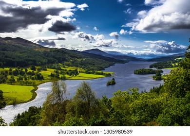 Panoramic View Over Loch Tummel And Tay Forest Park To The Mountains Of Glencoe From Queen's View Near Pitlochry In Scotland