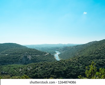 Panoramic view over Massif Central and the river Ardeche with blue sky