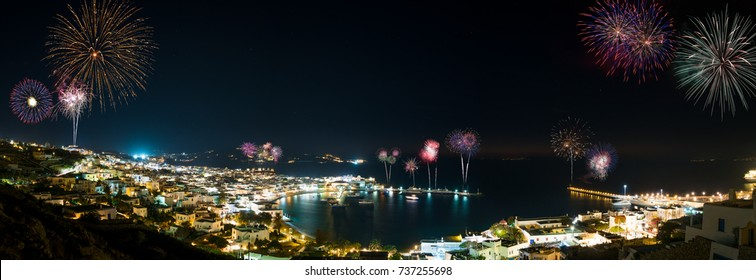 Panoramic view over Mykonos town at night with fireworks display, Greece