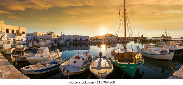 Panoramic view over the picturesque harbour of Naousa on the island of Paros, Cyclades, Greece, during a summer sunset