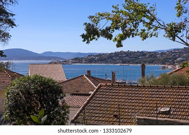 Panoramic view over the roofs of the village Sainte Maxime, over the Gulf of Saint Tropez. French Riviera. Blue Mediterranean Sea. Loving landscape.