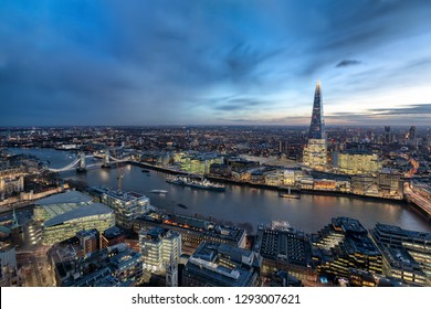 Panoramic view over the skyline of London by night along the Thames river to the Tower Bridge