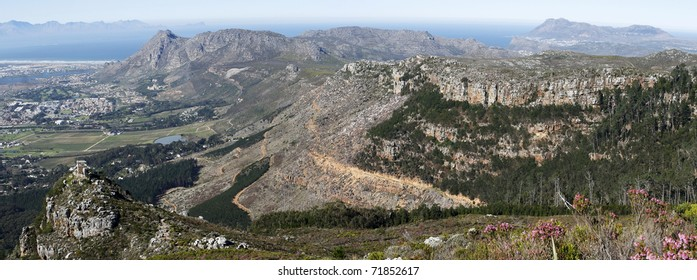 A panoramic view over the southern suburbs of Cape Town, Muizenberg, Tokai forest, Silvermine, False Bay and Cape Point, Cape Town, South Africa.
