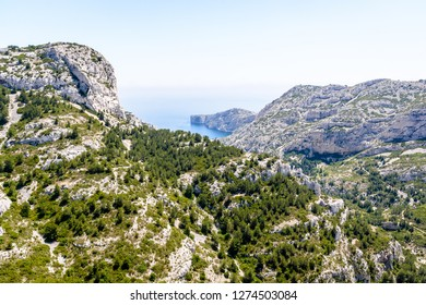 Panoramic view over the steep coastline of the massif des Calanques on the mediterranean shore in the south of France, on the path to the calanque de Morgiou near Marseille by a sunny spring day.