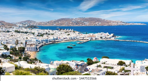 Panoramic view over the town and old port of Mykonos, Cyclades, Greece, with whitewashed houses and turquoise sea during summer time