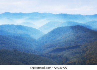 Panoramic view over valley covered in fog