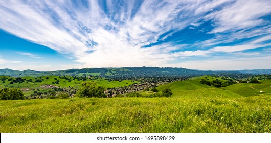 Panoramic view overlooking Camino Tassajara with hiking and walking trail on the slope of a hill in Sycamore Valley Preserve Contra Costa County Danville, California.