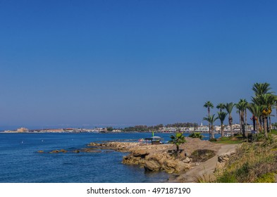 Panoramic view of of Pafos beaches. Beautiful sandy beach with large date palms
