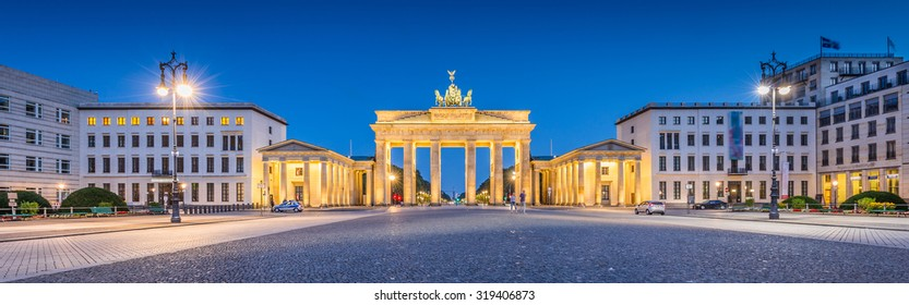 Panoramic view of Pariser Platz with famous Brandenburger Tor (Brandenburg Gate), one of the best-known landmarks and national symbols of Germany, in twilight during blue hour at dawn, Berlin, Germany
