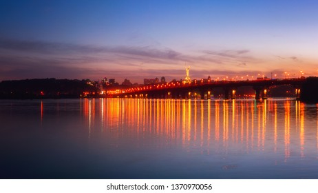 Panoramic view of the Paton bridge, Motherland monument and Dnieper river at night, beautiful cityscape with city lights, Kiev the capital of Ukraine