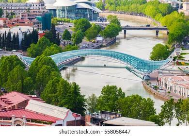 Panoramic view of Peace Bridge in Summer Rike Park in Tbilisi. Georgia