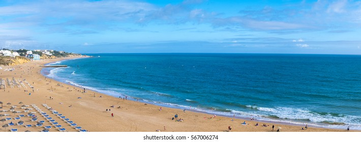 Panoramic view of people on the beach Praia da Rocha in travel destination Portimao. Algarve during the summer vacation, Portugal, Europe.