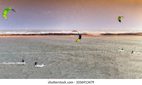 Panoramic view of people parasailing surfing with windy weather in El Portil, Huelva, Spain.