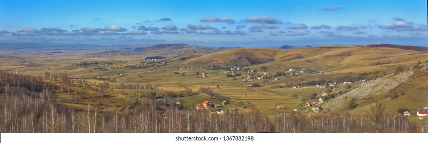Panoramic view of Pester plateau landscape in southwest Serbia. Cows on a pasture,