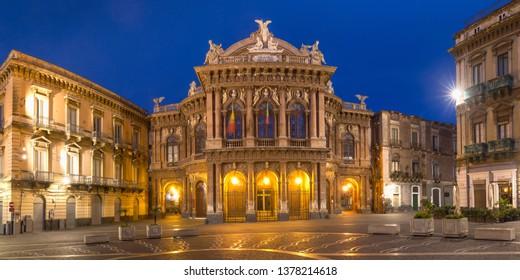 Panoramic view of Piazza Vincenzo Bellini and opera house grandiose theater Massimo Bellini in Sicilian Baroque style in the night lighting, Catania, Sicily, Italy