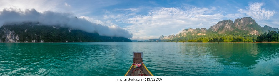 Panoramic view of picturesque Gorgeous Landscape View from longtail boat to Foggy Mountain and water, popular view of Rajjaprabha Dam (Cheow Lan Dam) in Khao Sok National Park, Surat Thani,Thailand