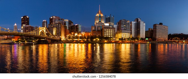 Panoramic view of Pittsburgh skyline from the Allegheny River after sunset