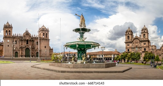 Panoramic view of Plaza de Armas with Inca fountain, Cathedral and Compania de Jesus Church - Cusco, Peru