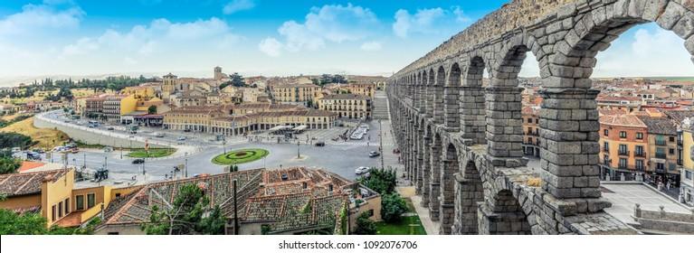 Panoramic view at Plaza del Azoguejo and the historic Roman aqueduct.