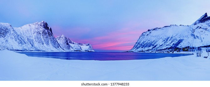 Panoramic view of polar beach and bay on island Senja in Lofoten islands archipelago in Norway, Scancinavia, Northern Europe. Beautiful dawn scenery. Fishing production spot.