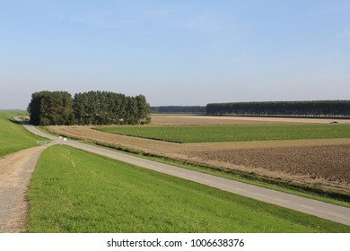 panoramic view at the polder landscape from the sea dike in holland in summer