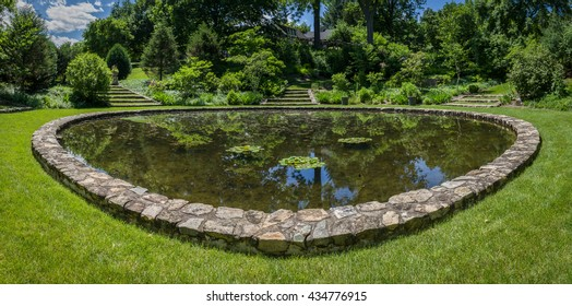 Panoramic view of pond surrounded by stones at Bamboo Brook Outdoor Education Center in Chester Township, NJ