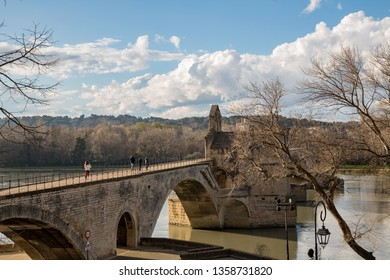 Panoramic view of the Pont d`Avignon and the Rhone River in Avignon, France. Only four arches survive due to flood damage. It is famous for the song Sur Le Pont d`Avignon.