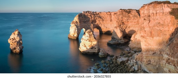 Panoramic view, Ponta da Piedade with seagulls flying over rocks near Lagos in Algarve, Portugal. Cliff rocks, sea and beaches, Algarve region, Portugal. Amazing landscape during summer season. - Shutterstock ID 2036327855