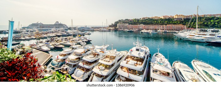 Panoramic view port of Monaco, luxury yachts in a row moored on Mediterranean Sea bay