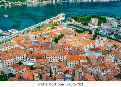 Panoramic view of port, town and mountains in Kotor, Montenegro