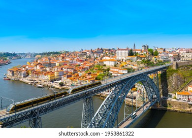 Panoramic view of Porto with Dom Luis I Bridge over the Douro River at sunny day - Shutterstock ID 1953861322