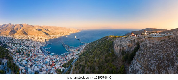 Panoramic view of Pothia Town, capital of Kalymnos, Greece, and Monastery of Agios Savvas located on top of hill, on left
