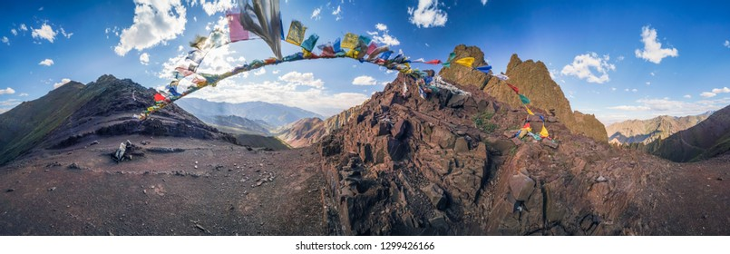 Panoramic view of prayer flags in beautiful Markha Valley in India in old Buddhist kingdom of Ladakh.