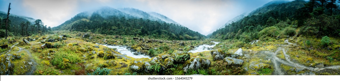 panoramic view of Prek Chu river at Kokchurang of Sikkim with it's lush green basin. Cloud covered mountains and rain washed greenery gives us this breathtaking landscape.