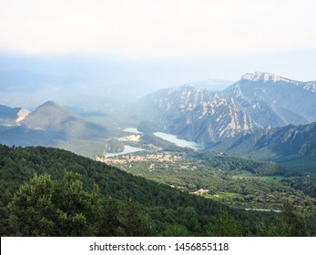 Panoramic view of the pre-Pyrenean area of Catalonia, with the Sierra Cadí, Llosa del Cavall pond and the small town of San Lorenzo de Morunys. Catalonia, Spain