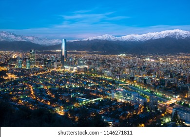 Panoramic view of Providencia and Las Condes districts with Mapocho River and Los Andes Mountain Range, Santiago de Chile