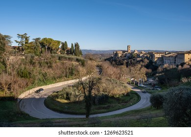 Panoramic view and  provincial road with the medieval towers of the village of Colle di Val d'Elsa, Siena, Tuscany