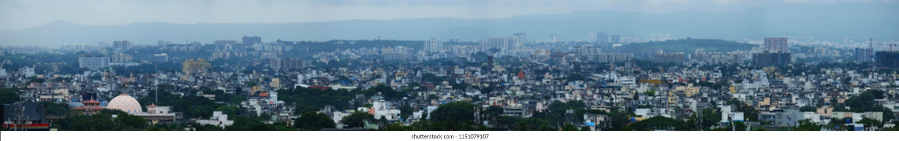 Panoramic view of Pune Cityscape Skyline, buildings holdings, Signboards, and banners, Pune, Maharashtra, India - 20 July 2018 