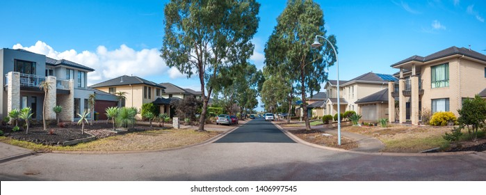 Panoramic view of a quiet suburban street lined with beautiful houses and trees in Melbourne's residential suburb. Sanctuary lakes, VIC Australia.