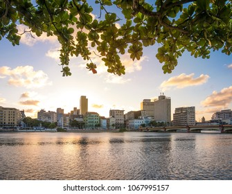 Panoramic view of Recife in Pernambuco, Brazil at sunset showcasing The Bairro de Sao Jose neighborhood by the Capibaribe River.