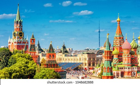 Panoramic view of the Red Square with Moscow Kremlin and St Basil's Cathedral in summer, Moscow, Russia. It is a main tourist destination in Moscow. Beautiful panorama of the heart of sunny Moscow.