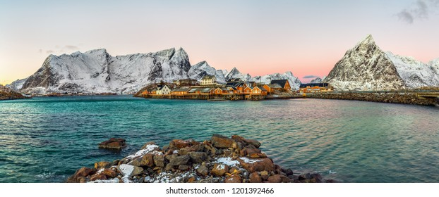 Panoramic view to Reinefjorden with Sakrisoy island and Lilandstinden mountain peak at sunrise - Reine, Lofoten islands, Norway