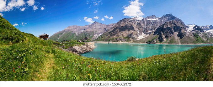 Panoramic view of Reservoir Mooserboden embedded in the impressive mountains of the Hohe Tauern near Kaprun, Austria.