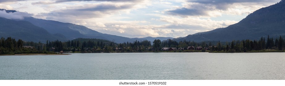 Panoramic View of Residential Homes near Green Lake during a cloudy summer sunset. Taken in Whistler, British Columbia, Canada.