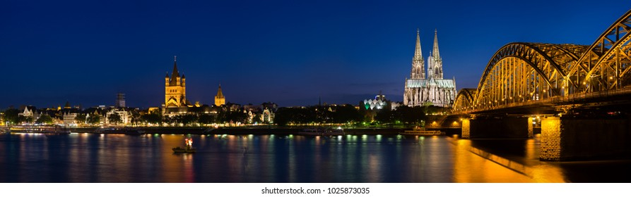 Panoramic view at the rhine river in cologne with St. Martins Curch, Cologne Cathedral and Hohenzollern Bridge.