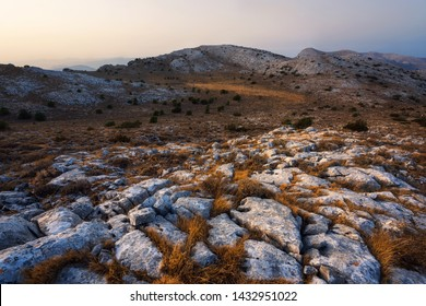 Panoramic view of the rock formations and grass on the top of Monte Albo in Sardinia, Italy